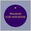 Colored plastic dog collar ID tag with engraved text of your choice.