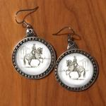 Pewter canter pirouette dressage horse earrings.