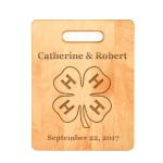 Personalized maple wood cutting board with engraved 4-H logo and text.