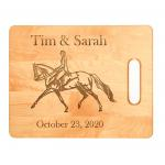 Personalized maple wood cutting board with engraved horse design 3 and text.