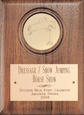 Horse show award plaque with brass engraved horse design circle and engraved brass plate.