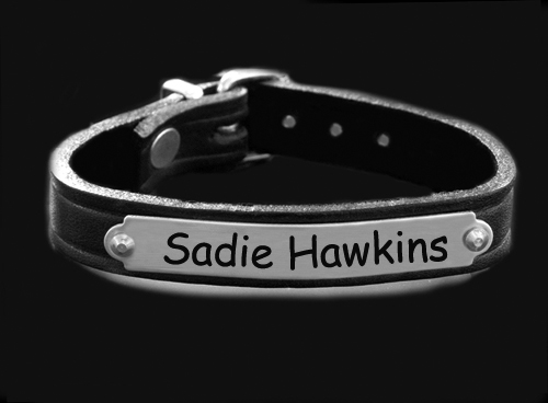Personalized silver engraved nameplate bracelet with custom engraved text.