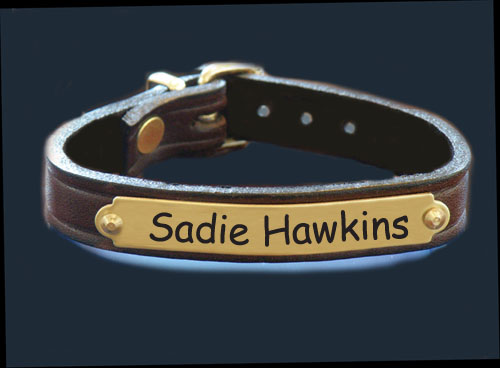 Personalized brass engraved nameplate bracelet with custom engraved text.