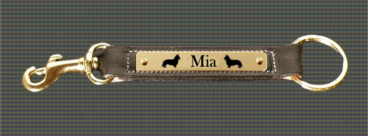 Personalized leather key fob with custom engraved brass Welsh Corgi dog design nameplate and a brass snap.