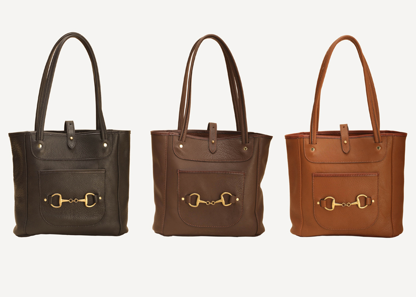 Leather carry all bags with a brass snaffle bit from Tory Leather.