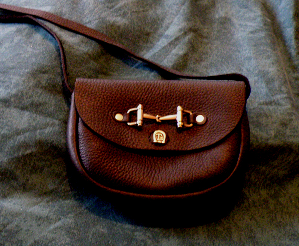 Mini bag / purse with decorative brass snaffle bit on front with a Velcro closure.
