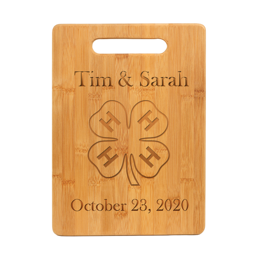 Custom engraved bamboo cutting board with engraved 4-H logo and personalized engraved text.