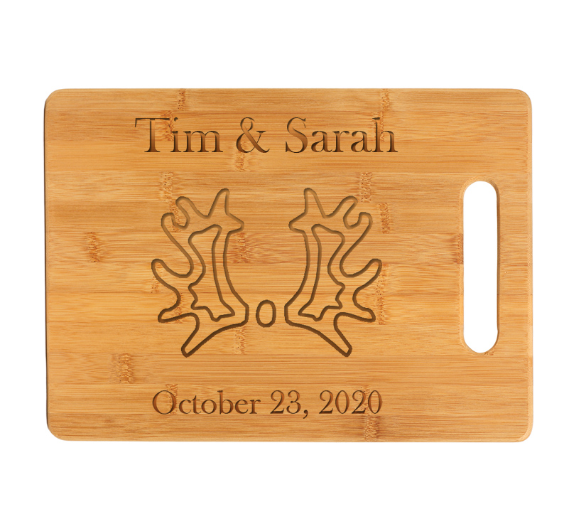 Custom engraved bamboo cutting board with engraved horse breed logo and personalized engraved text.