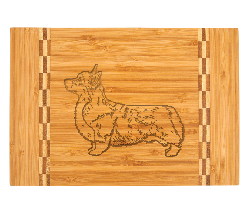Custom engraved bamboo cutting board with personalized text and Welsh Corgi dog design.