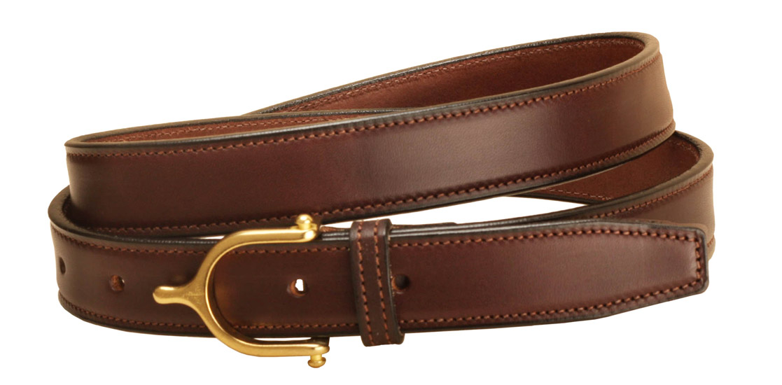 Brass English spur buckle on a 1 inch wide Havana leather belt.