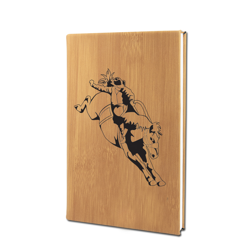 Personalized leatherette journal with custom engraved rodeo design and text.
