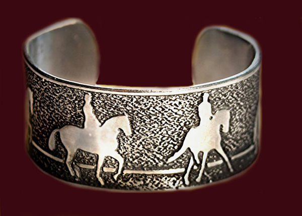 Dressage horse bracelet featuring the passage, piaffe', half pass and extended trot movements. Made out of pewter