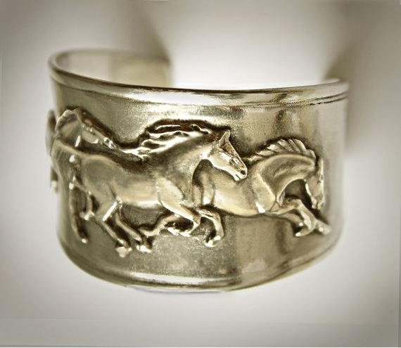 Equestrian jewelry bracelets that feature galloping mustangs and is made out of pure pewter.