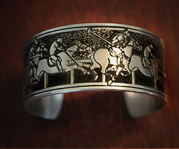 Pewter cuff bracelet with polo players and polo ponies.