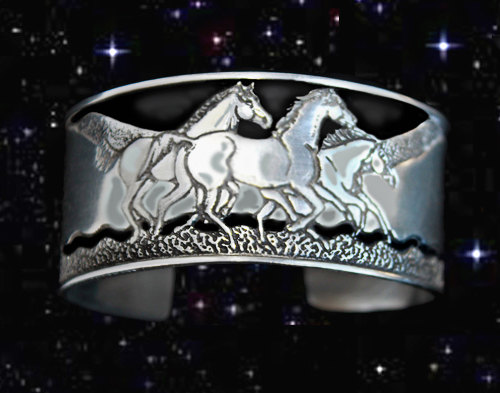 Equestrian jewelry bracelets that feature wild horses running free and is made out of pure pewter.