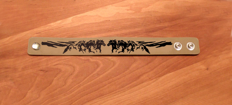 Decorative horse design leatherette equestrian bracelet.