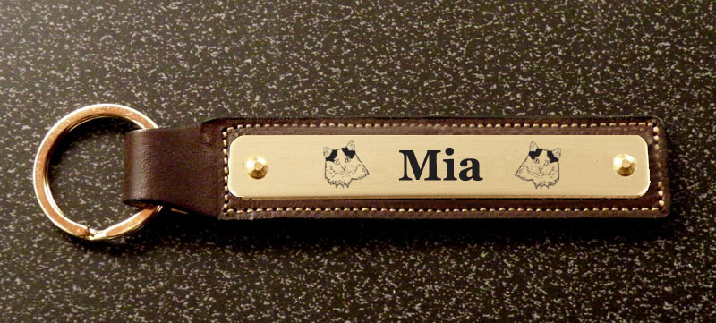 Leather key fob with a custom engraved cat design brass nameplate.