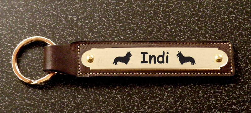 Custom engraved brass Welsh Corgi dog design nameplate on a leather key fob.