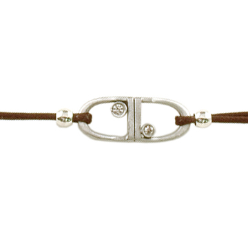 Equestrian jewelry bracelets that feature 2 English stirrups on a brown leather tie closure cord.