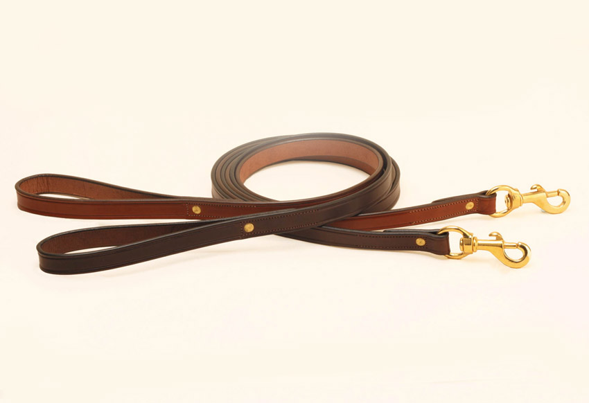 Tory flat creased leather dog leash with solid brass hardware.