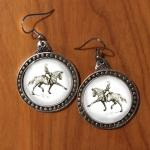 Pewter extended trot dressage horse earrings.