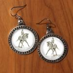 Pewter half pass dressage horse earrings.