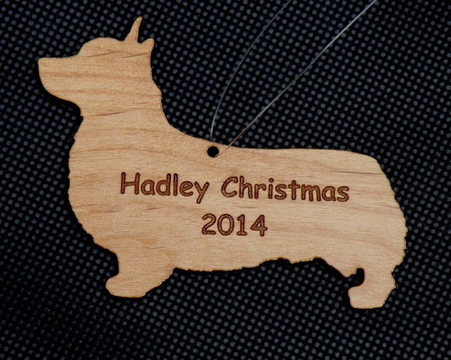 Personalized engraved and cut wood Christmas ornament in the shape of a Pembroke Welsh Corgi with custom engraved text.