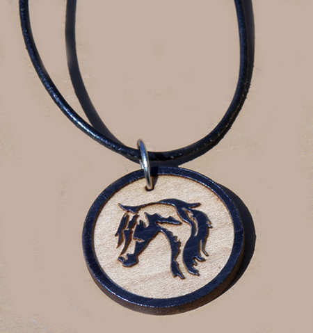 Engraved wood horse head design circle charm.