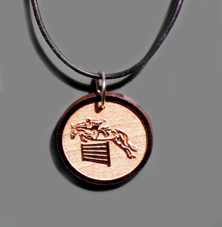 Custom engraved wood jumping horse design charm.